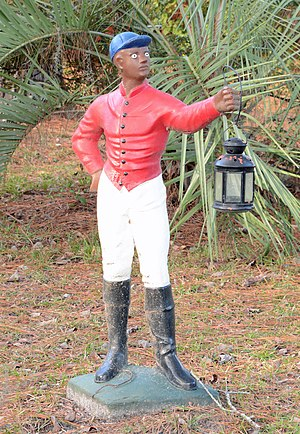 Lawn jockey - Example bearing a lantern in Guyton, Georgia