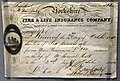 Life insurance certificate issued by the Yorkshire Fire & Life Insurance Company to Samuel Holt, Liverpool, England, 1851. On display at the British Museum in London.jpg
