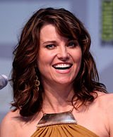 A colored photograph of Lucy Lawless smiling.
