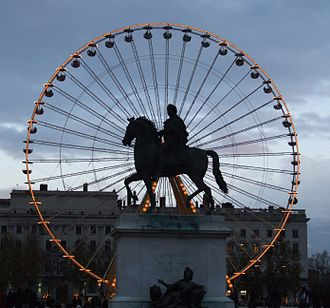Place Bellecour - Equestrian statue of Louis XIV, by François-Frédéric Lemot, with the Ferris wheel in the background