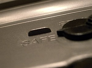 Safety (firearms) - Close-up shot of a safety of an M16A2 rifle