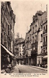Postal antigua que muestra la escena de una calle francesa en una zona no muy lujosa