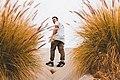 Man in sneakers at beach (Unsplash).jpg