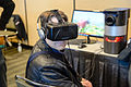 Man with Oculus Rift at computer (25812014795).jpg