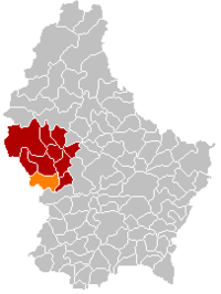 Map of Luxembourg with Beckerich highlighted in orange, the district in dark grey, and the canton in dark red