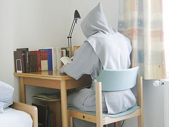 Trappists - A Trappist novice reading in his cell.