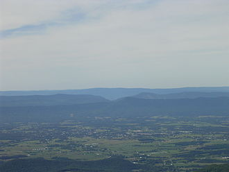 Massanutten Mountain - View of Massanutten Mountain from the east, looking west from Hawksbill Peak, with Luray in the foreground and the Great North Mountain in the background. August 2007.