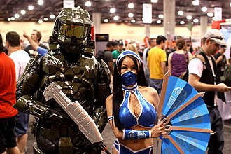 Kitana - A cosplayer of Master Chief (Halo) with Ying Behrens dressed as Kitana (MK2011 version) at Phoenix Comicon in 2012