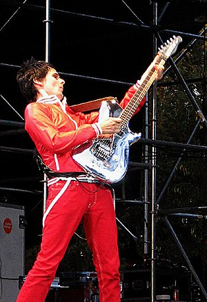 Matt Bellamy - Bellamy performing live at the Virgin Festival in Toronto using the Manson guitar; Chrome Bomber Manson.