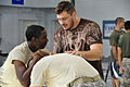 Matt Mitrione teaching clinch fighting maneuvers (110920-A-GI410-133).jpg