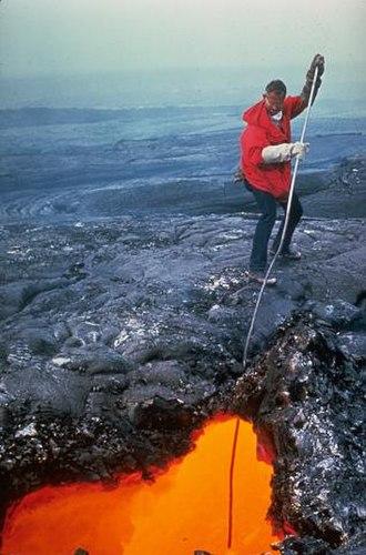Volcanologist - Sampling the lava tube on the flanks of Mauna Ulu, Kilauea, Hawaii, United States