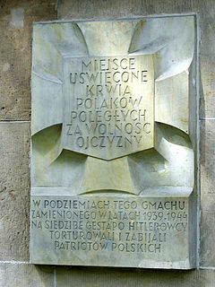 Tchorek plaques design of memorial plaque commonly found in Warsaw, Poland