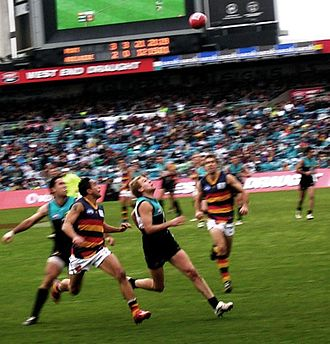 Andrew McLeod - McLeod challenging a mark in a game against Port Adelaide