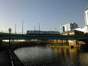 Pomona tram stop - A Metrolink tram crossing the Manchester Ship Canal at Pomona