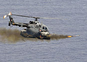 Mexican BO-105 Bolkow helicopter fires 2.75 inch high-explosive rockets at the ex-USS Connolly (DD 979).jpg