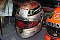 Michael Schumacher 2012 Belgian GP Platinum helmet replica front-left 2019 Michael Schumacher Private Collection.jpg