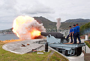 RML 9 inch 12 ton gun - Restored Mark I, RML 9 inch 12 ton gun being fired at Simon's Town in 2014, with replica ammunition in the foreground