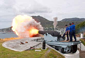 RML 9-inch 12-ton gun - Restored Mark I, RML 9-inch 12-ton gun being fired at Simon's Town in 2014, with replica ammunition in the foreground