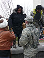 Military police officer in uniform assists lady climbing down from Washington Monument 1 Inauguration 2013.jpg