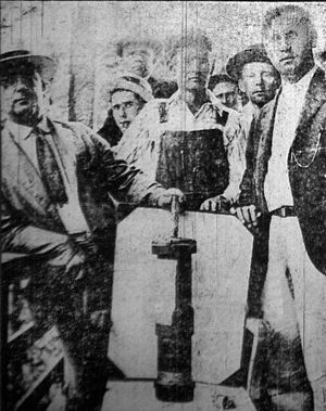Battle of Blair Mountain - A group of miners display one of the bombs dropped by Chafin's airplanes.