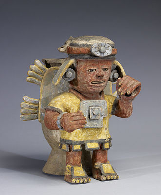 Figurine - Image: Mixtec Polychrome Standing Figure with Raised Hand Walters 482812 Three Quarter