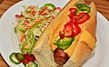 Mmm... hot dog with cheese sauce (6190694912).jpg