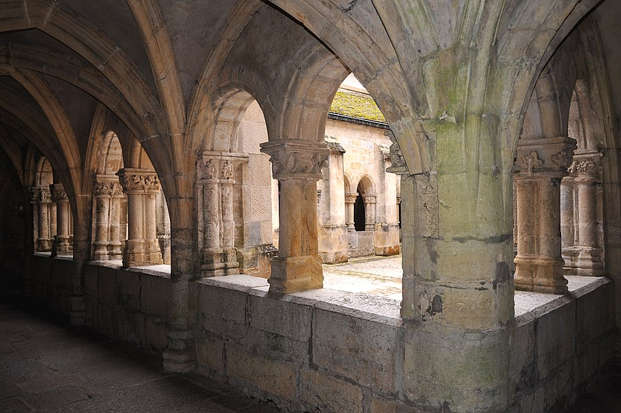 Ancient Augustinian abbey, cloister; Montbenoît, France.