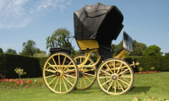 Phaeton (carriage) - The sporty Lord Lonsdale's yellow phaeton with a calash top, ca 1900 (Mossman Collection)