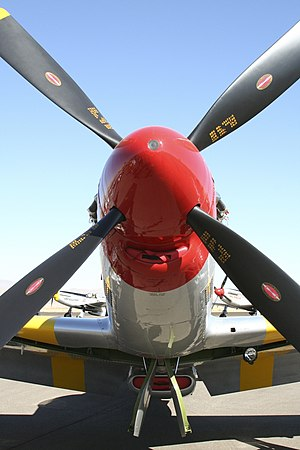 Spinner (aeronautics) - North American P-51 Mustang with a large-style spinner that fits over the propeller.