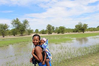 Continuum concept - Namibian woman with her baby on her back