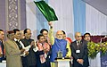 Narendra Modi flagging off the first train from Mendipathar in North Garo Hills of Meghalaya to Guwahati, at the Maligaon Railway Stadium in Guwahati, in Assam. The Governor of Assam, Shri Janaki Ballabh Patnaik.jpg