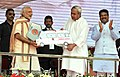 Narendra Modi presenting the keys of ambulance to the Chief Minister of Odisha, Shri Naveen Patnaik, at the inauguration ceremony of Paradip refinery.jpg