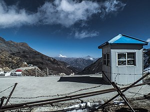 Nathu La - Distant mountains of Bhutan, the Tibetan side, and international border fence as seen from the Indian side at Nathu La