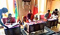 Nirmala Sitharaman and the Minister of Economic Affairs of Bhutan, Mr. Lyonpo Lekey Dorji signing the India-Bhutan Agreement on Trade, Commerce and Transit, in the presence of the Prime Minister of Bhutan.jpg