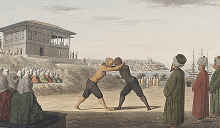 Ottoman wrestlers in the gardens of Topkapi Palace, in the 19th century Oil wrestling match in the gardens of the Sultan's Palace.jpg