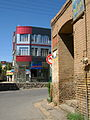 Old brick made house and new aluminium front building - Manuchehri st - Nishapur 4.JPG