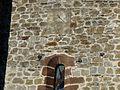 Orgnac-sur-Vézère église cadran et reliefs.jpg