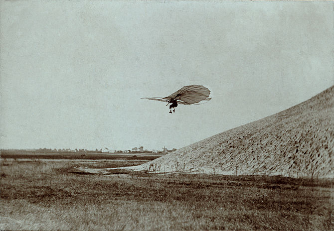English: Otto Lilienthal performing one of his...