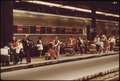 PASSENGERS AND LUGGAGE MAKE THEIR WAY BETWEEN TRAINS IN CHICAGO'S UNION STATION. TRAVEL BY RAIL HAS INCREASED SINCE... - NARA - 556074.tif