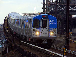 PATH (rail system) - A PATH train of PA-5 cars on the Newark – World Trade Center line, crossing the Passaic River en route to the World Trade Center