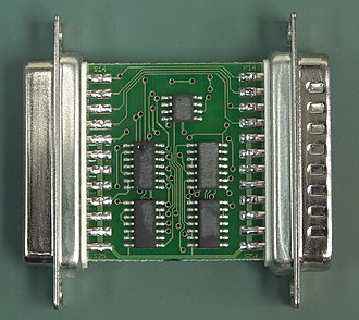 Software protection dongle - A Rainbow Tech parallel port dongle PCB, front side. Note the numbers rubbed off the chips to make reverse engineering harder