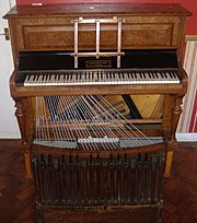 An upright pedal piano