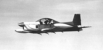Peter Garrison - Peter Garrison test-flying the as-yet unpainted Melmoth in 1973. Yarn tufts on fuselage reveal air flow over wing. The horizontal tail was later moved to the top of the vertical tail.