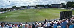 Interior view of the County Ground in Derby with a large number of people in the stands