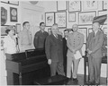 Photograph of President Truman at the White House receiving a piano from the Piano Manufacturers Association that was... - NARA - 200296.tif