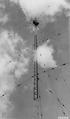 "Photograph of Tower Men Installing and Adjusting ""J"" Type Antenna - NARA - 2129586.tif"