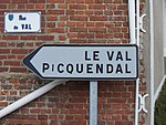 A streetsign in Merck-Saint-Liévin, Pas-de-Calais, showing Germanic influence in local toponyms. The name Picquendal corresponds to the modern Dutch Pikkendal.