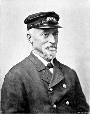Black and white photograph of a man with a short white beard wearing a uniform.