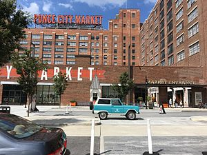 Ponce City Market - The entrance of Ponce City Market showing the large neon sign on the rooftop.