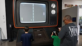 Video game - People playing a large scale version of the iconic Pong video game at the National Videogame Museum.